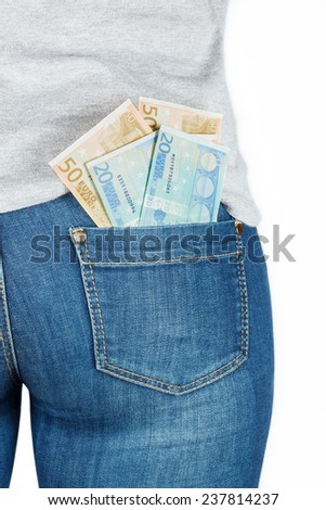 Euro. Paper money in the pocket of jeans. Isolated on white background.
