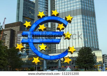 Euro Symbol in Frankfurt by night - stock photo