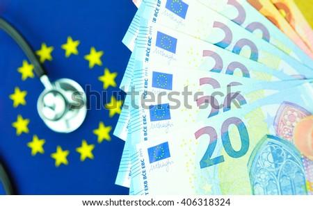 Euro zone concept with stethoscope end EU flag - stock photo