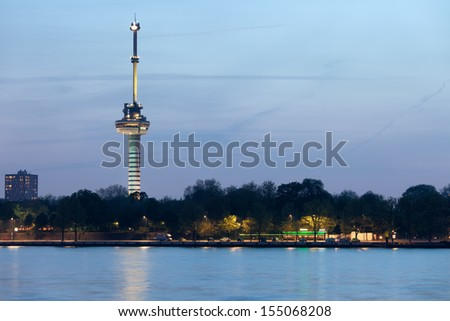 Euromast tower at twilight in Rotterdam, Netherlands, river view.