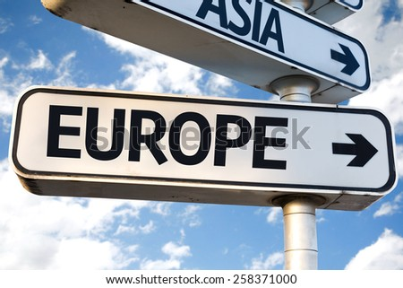 Europe direction sign on sky background - stock photo
