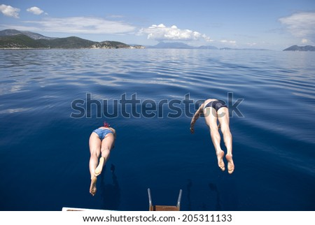 Europe, Greece, Ionian, Mediterranean Sea. The synchronous jumps in the sea from the yacht.