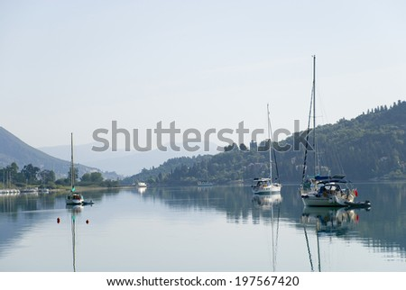 Europe, Mediterranean Sea, islands of Greece. Yachts in a bay at the island of Corfu. - stock photo