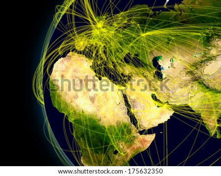 Europe, Middle East and Africa viewed from space with connections representing main air traffic routes. Elements of this image furnished by NASA. - stock photo