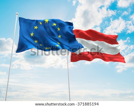 Europe Union & Austria Flags are waving in the sky with dark clouds