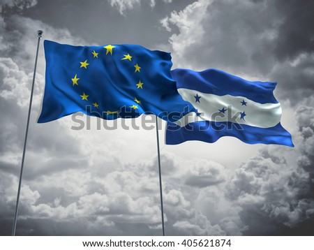 Europe Union & Honduras Flags are waving in the sky with dark clouds