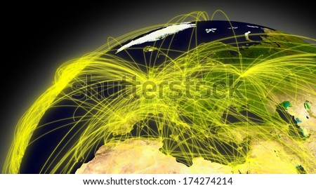 Europe viewed from space with connections representing main air traffic routes. Elements of this image furnished by NASA. - stock photo