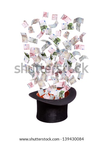 european banknotes flying out of old top hat - stock photo