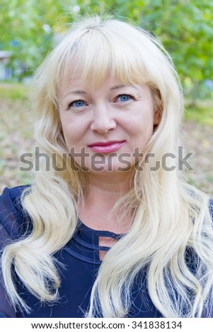 European blond woman with long hair and blue eyes - stock photo