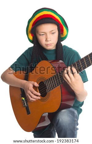European boy with guitar and hat with artificial dreadlocks. - stock photo