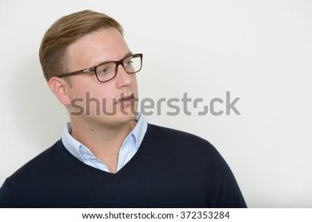European businessman looking sideways  - stock photo