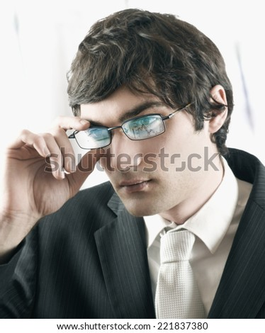 European businessman with reflection on eyeglasses
