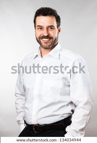 European, Caucasian business man about 40 years old in a white shirt. Studio portrait.