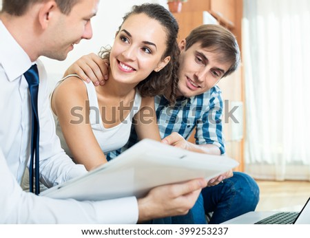 european couple and banking agent discussing possibility of mortgage