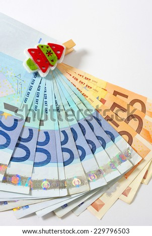 European currency and Christmas decoration