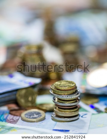 European Currency stacked Coins on Banknotes (close-up shot)