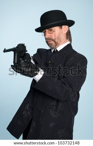 European, dressed in traditional Chinese costume shoots a gun. - stock photo
