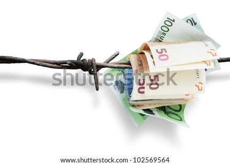 European financial crisis. Money on barbed wire. - stock photo