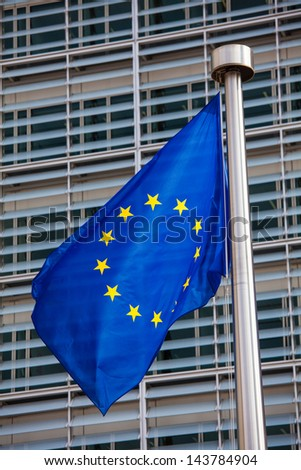 European flag in front of the Berlaymont building, headquarters of the European commission in Brussels. - stock photo