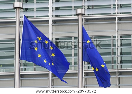 European flags floating in front of the European Commission Building in Brussels - stock photo