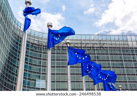 European flags in front of  headquarters of European commission in Brussels in summer day - stock photo