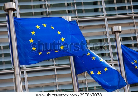 European flags in front of the Berlaymont building, headquarters of the European commission in Brussels. - stock photo