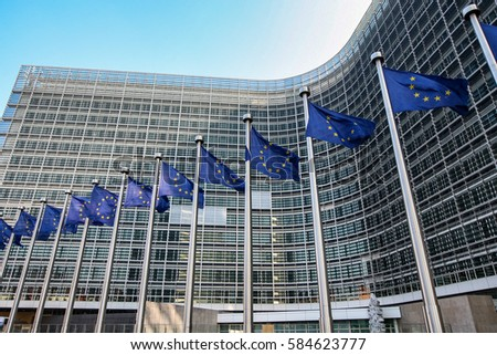 European flags on the background of the European Parliament