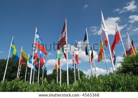European flags united in a group, photographed against blue vibrant sky.  Diversity, leadership, union concept.
