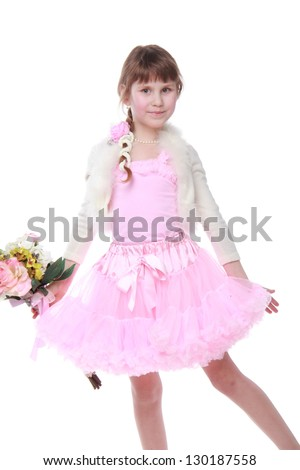 European girl in a pink dress/Cute baby with a bouquet of flowers on Mother's Day