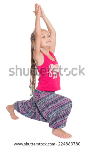 European girl performs gymnastic exercise in Thai dress. The girl is six years old. - stock photo