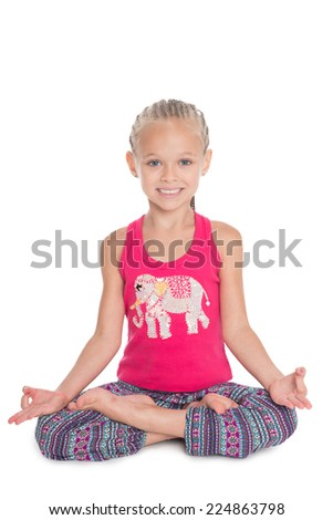 European girl sitting in the lotus position. Girl is six years old. - stock photo