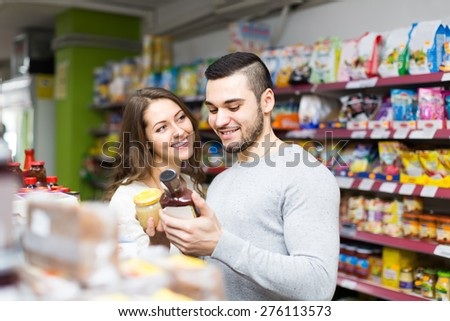 european happy family purchasing food for week at supermarket