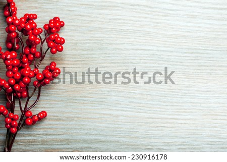 european holly on a wooden surface - stock photo