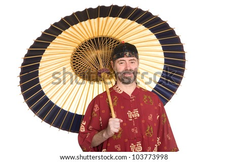 European in the traditional Chinese dress holding an umbrella. Umbrella is made of bamboo and paper - stock photo