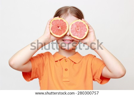 European little gil holding delicious grapefruit