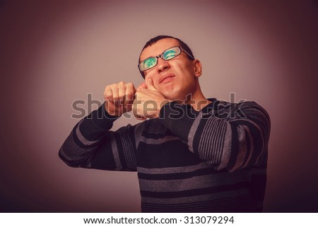 European-looking male of about thirty brunet squeezing a pimple on the face, pimply cross process retro - stock photo