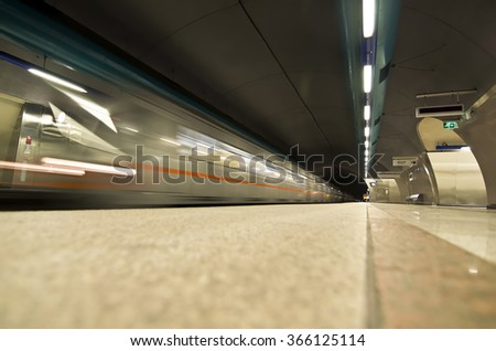 european metro subway station - moving metro train - european public transportation  - stock photo