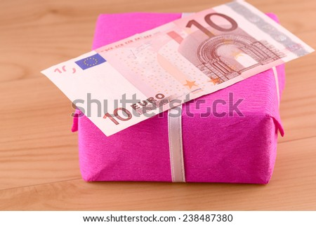 european money and red gift box - stock photo