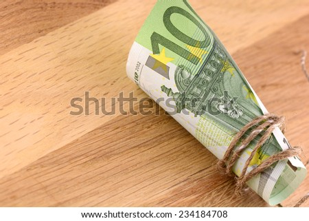 european money on wooden background - stock photo