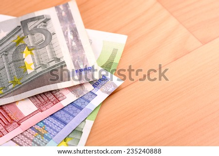 european money set on wooden background - stock photo