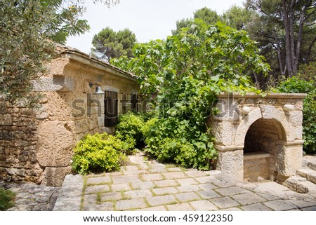 European old stone farmhouse with a drinking fountain in Croatia
