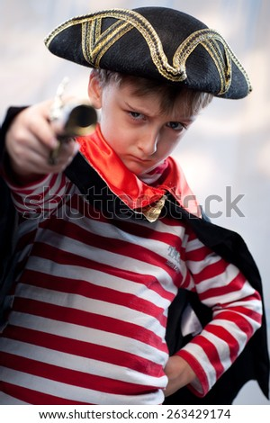 European stern boy pirate with pistol - stock photo