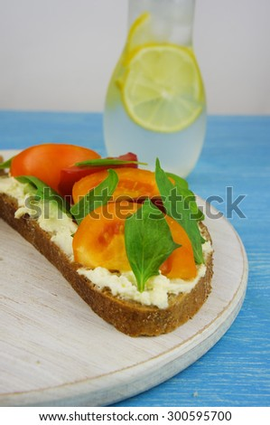 European style sandwiches with Roquefort cheese and Basil leaves on dark bread. - stock photo