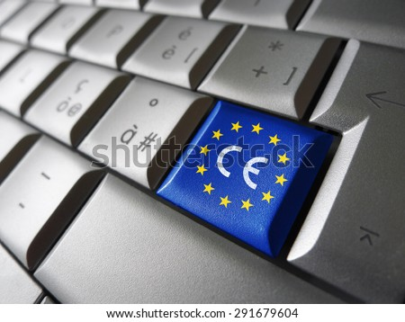 European Union and EU community CE marking concept with sign, symbol and EU flag on a computer key. - stock photo