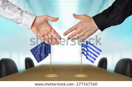 European Union and Greece diplomats agreeing on a deal - stock photo