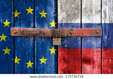 European Union and Russian flag on the background of old locked doors