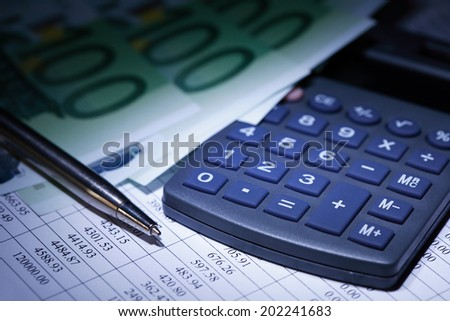European Union Currency near calculator and pen on paper background with digits table