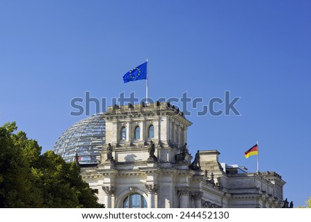 European Union (EU) and German flag on the national German parliament (Reichstag building) - stock photo