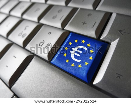 European Union financial concept image with euro symbol, sign and icon on a laptop computer key with EU flag for blog, website and online business. - stock photo