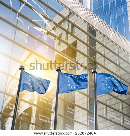 European union flag against parliament in Brussels, Belgium - stock photo
